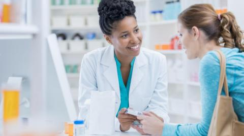 Pharmacists talking with a patient