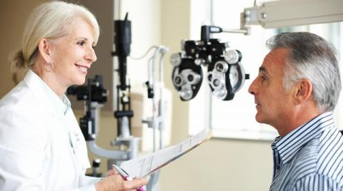 Optometrist with her patient