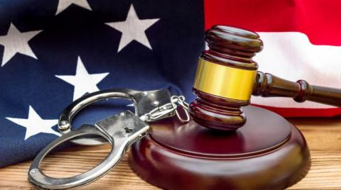 Gavel, handcuffs and an American flag
