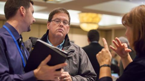 Picture of three attendees at Raise the Bar Conference