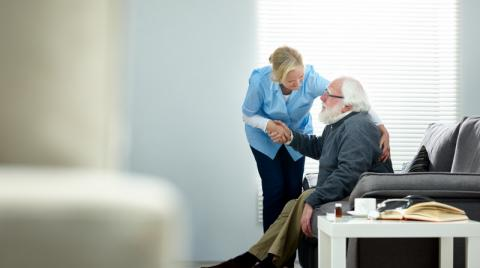 Caregiver with elderly man