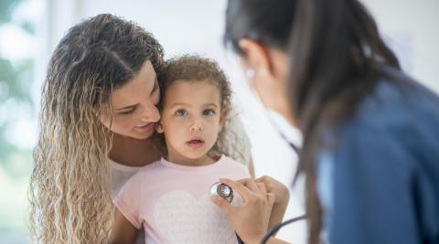 Mother and daughter at doctor