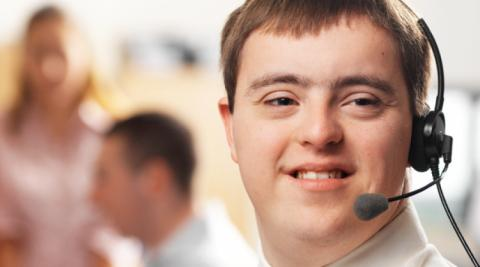 Man with down syndrome working in call center