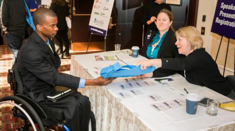 Man in wheelchair attends conference