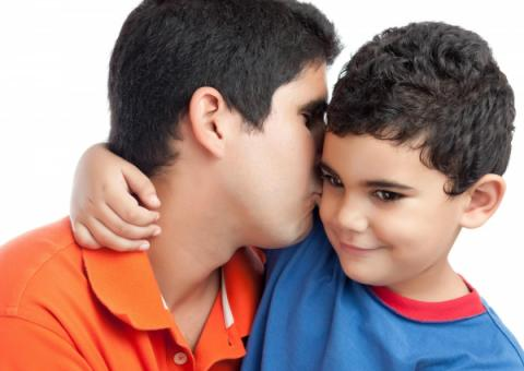 Father kissing son on the cheek