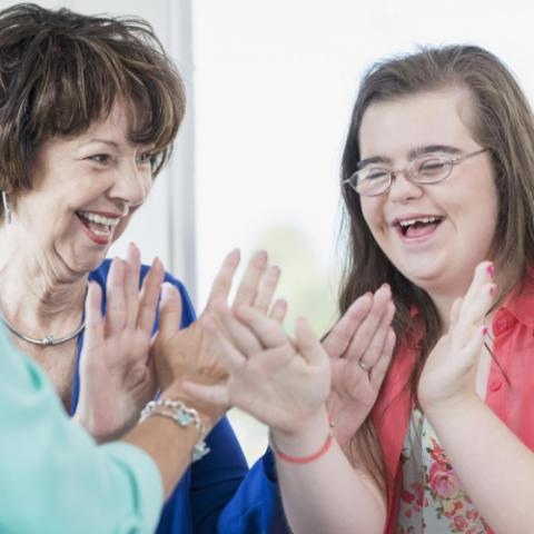 Girl with Down Syndrome and her family