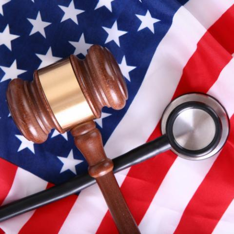 American flag with gavel and stethescope