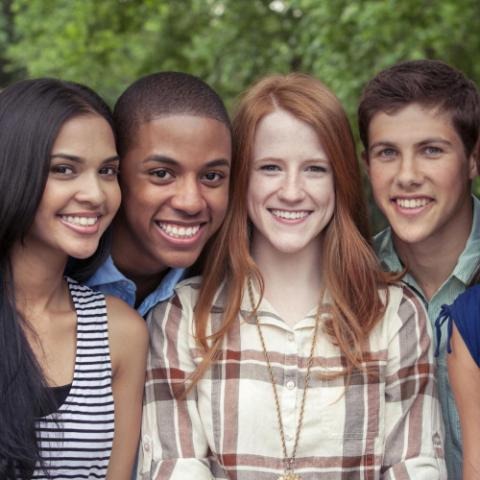 Group of teenagers smiling for a picture