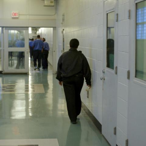Correctional officer and inmates in a prison.
