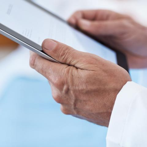 Reviewing medical records on a tablet