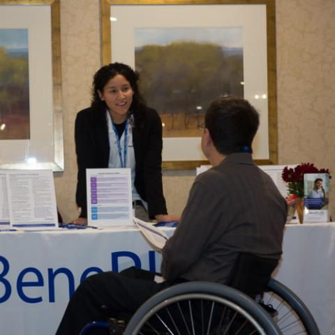 Man in wheelchair at Raise the Bar Hire! conference