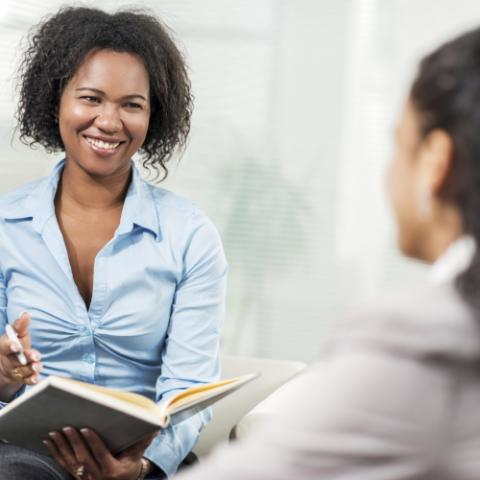 Woman speaking with employee