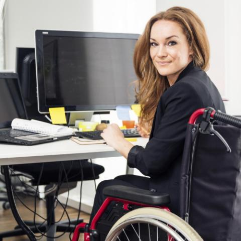 Woman in wheelchair working