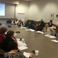 Community college partners discuss direct care worker curriculum at launch meeting.