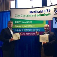 Marty Baker and Scott Waterhouse, CIO of Resources for Seniors, celebrate NASUAD technology contest wins.