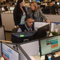 Lt. Gov. Karyn Polito, Contact Center Manager Kerrie Topi observe call in action