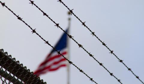Flag near barbed wire