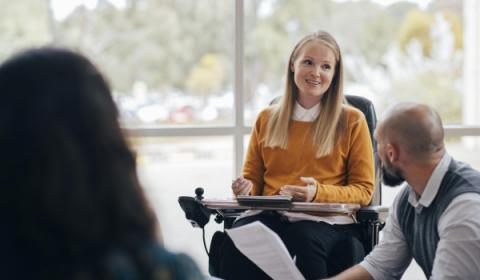 Person in a wheelchair leading a meeting
