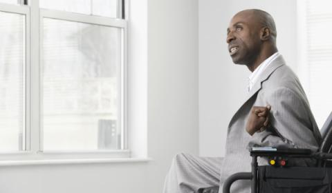 Businessman in a suit looks out a window