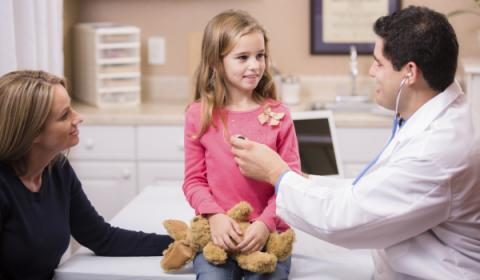 Child being examined by a doctor