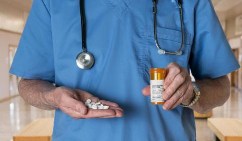 Doctor holding opioids