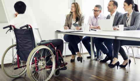 Man in wheelchair giving presentation