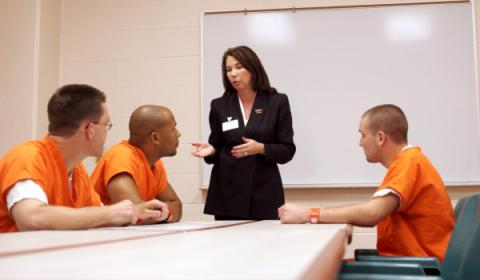 Woman speaking with prisoners