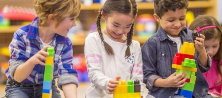 Children playing with blocks in a classroom
