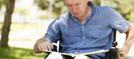 handicapped man reading a book
