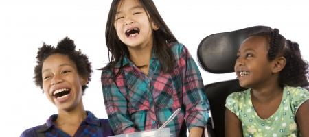 Children laughing over lunch
