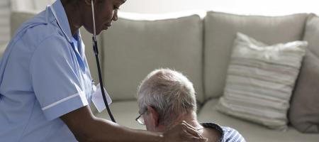Doctor caring for an elderly patient