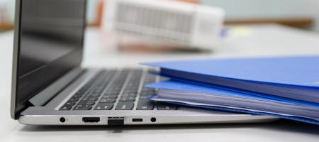 Folders and laptop