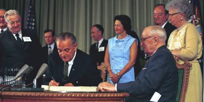 President Lyndon B. Johnson signing Medicaid into law