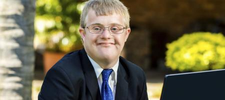 Young businessman with disabilities at computer