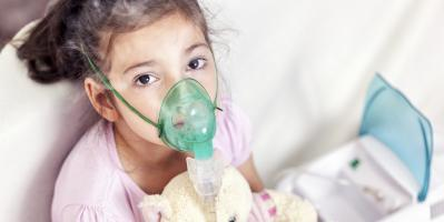 Little girl receiving asthma treatment